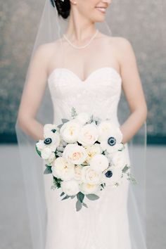 Wintery white anemone + rose bouquet: http://www.stylemepretty.com/missouri-weddings/st-louis/2016/01/25/classic-st-louis-opera-house-wedding/ | Photography:  Mike Cassimatis - http://www.mnc-photography.com/