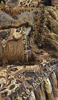 The Renaissance collection combines a palette of rich bronze and black tones in soft chenilles, velvet, embroidered organza and a faux mink fur. The pillows are embellished with beautiful beads, tassel fringe, braids and Swarovski crystals. Design elements combine here to create a rich look that is both feminine and masculine. Our over sized bedding is designed to fit the larger beds of today with ample drop on both the duvet and the dust skirt.