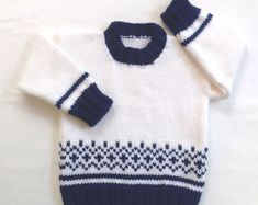 Age 12 to 24 months. This little toddler sweater is suitable for both baby boys and girls - an ideal Christmas sweater. It is white with contrasting ribbings in a bright red, and with a cute Fair Isle pattern on both the front and back. Measurements are below. I knitted this little sweater in easy care, medium weight, acrylic yarn, machine wash cool, gentle cycle, and short machine dry, low heat, or lay flat to dry. Please read my policies and FAQ for more information. Age 12 - 24 months…