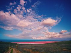 Australia's Lake Hillier maintains its vibrant pink color year-round, even when bottled. The cause of the color remains a mystery, though some say it could be the result of its high salt content combined with the presence of a pink bacteria species.