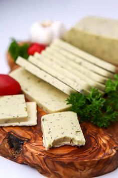 This rich and creamy garlic herb vegan cheese is perfect for slicing. Made with coconut milk, it's dairy-free, gluten-free, and nut-free. Coconut Cheese, Vegan Cream Cheese, Coconut Milk, Vegan Keto, Vegan Gluten Free, Dairy Free, Vegan Cheese Recipes, Hidden Veggies, Nut Free