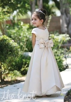 Dress features large bow on back.