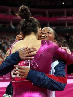 Gabrielle Douglas of the United States hugs Alexandra Raisman after Douglas wins the gold medal in the Artistic Gymnastics women's Individual All-Around final on Day 6 of the London 2012 Olympic Games at North Greenwich Arena.