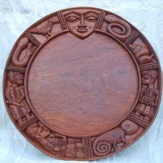 theasefountain:      The opon Ifa (Ifa divination board) I had made for me by Lukman Fakeye of Ibadan, Nigeria. It features images of Egungun (ancestors), bata and dundun drummers, agemo (chameleon), igbin (snail) and python - animals sacred to Obatala, egedu (mudfish), bird and Esu. Àse! Aboru aboye abosise!