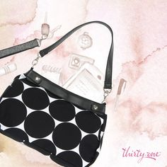 The Suite Skirt Purse in Big Dot will help you carry yourself to success.