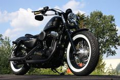Customized Harley-Davidson Sportster Forty-Eight with new brass grips&controls, exhaust and leather saddle. Built by Thunderbike Customs Germany Harley Davidson Sportster, Sportster 48, Custom Sportster, Harley Davidson Bikes, Bobber Motorcycle, Motorcycle Garage, Motorcycles, Forty Eight, Biker Clubs
