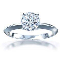 Google Image Result for http://eliteweddinglooks.com/wp-content/uploads/2012/03/simple-engagement-rings-with-diamond.jpg