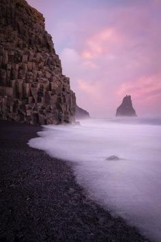 South coast of Iceland, black volcanic beach and rock formations in the town of Vik.  BE CAREFULL..THE SEA  CAN TAKE YOU OUT..:(