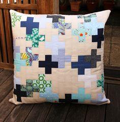 It's a Plus cushion by Hazelnutgirl, via Flickr