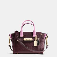 Finished by hand in refined pebble leather with a gorgeous pop of contrast color, this charmingly petite carryall gets its Swagger from statement belting and bold double-turnlock hardware. The long strap snaps on with ease for a hands-free carry.
