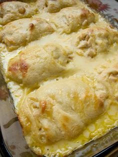 Chicken Roll Ups ~ chicken breasts wrapped in crescent rolls and smothered with cream of chicken soup, milk and cheese... Delish!