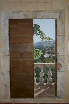 This painting on the wall looks very realistic like you could almost just walk out on the deck.