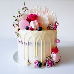 White wedding drip cake with pink accents