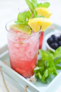 Pineapple Blackberry Mojitos – the BEST summer cocktail recipe! Pineapple, blackberries, and mint are crushed and then mixed with rum, lime juice, and sparkling water!