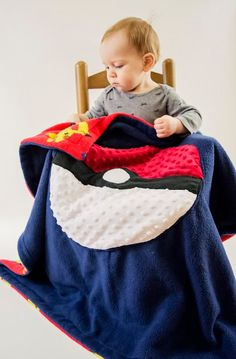 Thanks for looking at, The Nerdy Nest!  This awesome, Pokeball inspired blanket, has been one of my personal all time favorites! Notice, my son