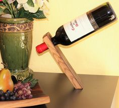 This self-balancing wine bottle holder is made from a reclaimed Napa Valley wine…