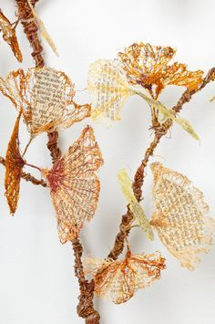 Amnesia, detail of artists book  by Lisa Kokin - thread, book pages, wire, fauxliage of gingko waves incorporates text fragments from Silent Springby Rachel Carson. Published in 1962, it was the first widely read book on environmental pollution caused by pesticide.