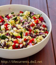 For Easter we had a (not so traditional) taco bar. Dan grilled up a big ol' mess of fajita veggies and carne asada. We had rice and beans, cheese, lettuce, salsa, guacamole, tortillas. One of the things I made was this Mexican Corn Salad. #Mexican #corn #salad #vegan