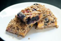 Blueberry Peach Oat Crumble Bars are made by nestling fresh peaches and blueberries between layers of sweet oatmeal crumble for an easy summer dessert.