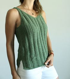 This unique, Tunisian crochet top features a flattering, V neckline, fun side slits, and a beautiful, open upper back. It's filled with classic, knit-like texture (created from alternating beginner stitches) and has perfectly shaped armholes so there's no awkward, bulging fabric! Plus, like most of my designs, no undershirt is required! Crochet Tank, Crochet Hooks, Row By Row, Dk Weight Yarn, Tunisian Crochet Patterns, Knitting Patterns, Awkward, Tops, Ravelry