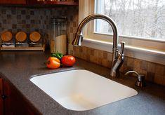 Corian kitchen sink. Popular trend for a contemporary kitchen design.