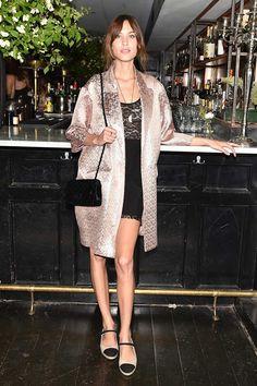 Alexa Chung in a LBD, a bllush foil coat, and flat espadrilles.