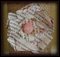 Book page flower with vintage button.  I made a few of these for our Valentine's Day decor.