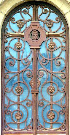 Ornate door in Barcelona, Spain.