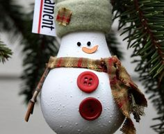 snowman light bulb ornament with hat, scarf and buttons