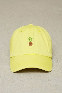 7118c851aa1 A cotton baseball cap featuring a front pineapple embroidery