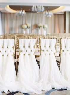 White linens gold seating: http://www.stylemepretty.com/little-black-book-blog/2016/12/01/elegant-glamorous-baltimore-ballroom-wedding/ Photography: Michael and Carina - http://www.michaelandcarina.com/