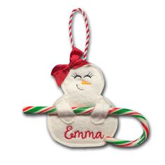 Snowgirl Candy Cane Holders - Stitch darling little Snowgirl Candy Cane Holders that double as Christmas Tree Ornaments! Personalize her with your embroidery software or embroidery machine to create a keepsake to enjoy year after year!