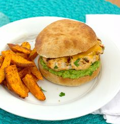 Cheddar Jalapeño Chicken Burgers with Guacamole Recipe Main Dishes with ground chicken, yellow onion, chopped fresh cilantro, garlic, jalapeno chilies, ground cumin, paprika, lime, shredded cheddar cheese, kosher salt, pepper, burger buns, cheddar cheese, guacamole
