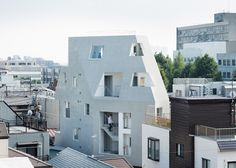 Faceted Tokyo apartment building fits into a dense location