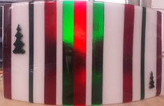 Great new Christmas light sconce- created at AMusinGlass from fused glass strips & christmas tree cut outs