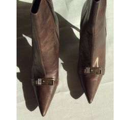 Boots Boots; booties, brown, heels..... Some visible wear on the inside of shoe Guess Shoes Ankle Boots & Booties