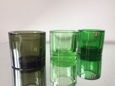 3 candleholders in green colors Designed by Heikki Orvola in 1988 6 cm tall and 6 cm wide In very good used condition Marimekko is embissed on the base Marimekko, Mid Century Design, Green Colors, Etsy Store, Shot Glass, Stoneware, Glass Art, Candle Holders, Conditioner