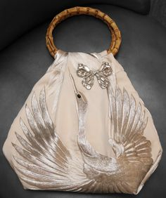 White Silk Kimono accessory bag for wedding dress.  Designer and Tailor;  Miranda
