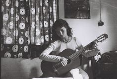 Solitary moment with her guitar- Founder of The Village Link. Circa 1977.