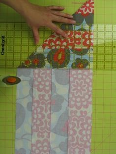 Cutting a Perfect Square Tip: Fold the fabric diagonally at 90 degrees...then using your grid ruler cut the fabric along the edge, as shown.