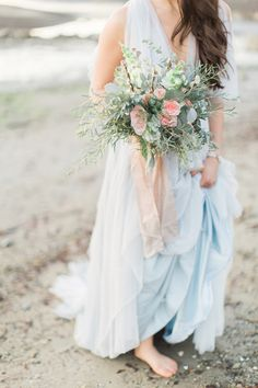 Photographs of a beach wedding in a color palette of icy blues and soft pinks. Check for some inspirations.