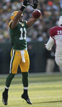 Green Bay receiver Jarrett Boykin just misses blocking a punt. : Packers 31, Cardinals 17