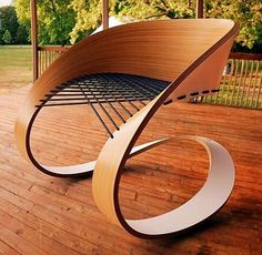 Carnaval Chair by Guido Lanari & Jesica Vicente. The frame is made from a single strip of #plywood that's bent to form a complete loop, with the gap then spanned by an interlaced elastic bungee cord. #design #igers #designers #rare #sculpture #art #interior #luxury #productdesign #furniture #chair #modern #minimalist #archidaily #instacool #goodvibetribe #woodwork #rendizen