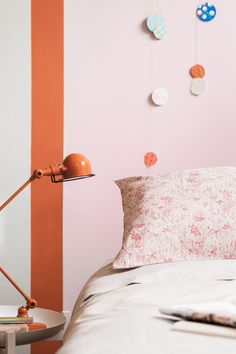 Giving your kid's room a quick update can be as easy as painting a few bold colourful stripes. Update a pastel pink room (this is Candy Love) with a dash of Tangarine Twist for a whole new look.