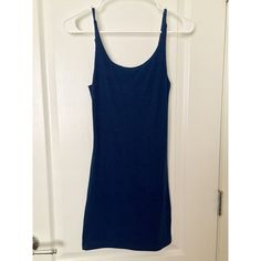 Ribbed bodycon dress Navy blue color.  Never worn.  Adjustable straps.  Above the knee. Dresses Mini