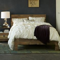 Love this wood look for a bed made softer with the bedding.  White ornate side tables or mirrored ones or metallic lamps would balance it.  Emmerson Bed   west elm