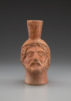 Molded head-flask, Roman, Tunisian, 3rd-4th century A.D. Terracotta, 19cm (7 1/2in.). Gift of Ambassador and Mrs. William L. Eagleton, Jr., B.A. 1948. Photo credit: Yale University Art Gallery