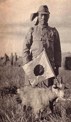 A Japanese soldier poses with a captured Russian Goat, 1939 Battle for Khalkhin Gol, August 1939