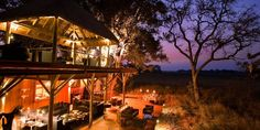 Overlooking a lagoon, the earthy glamour of this striking Botswana safari lodge provides a perfect counterpoint to the natural bounty of the riverside Okavango Delta, African Safari, Lodges, Places Ive Been, Camping, Rustic, House Styles, Luxury, South Africa
