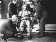 American serial killer, rapist & cannibal, Albert Fish, being strapped into the electric chair, 1936.